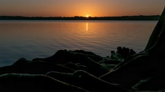 Sunrise over calm White Rock Lake in Dallas- motion time-lapse Stock Footage