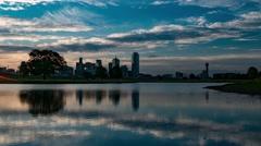 Dallas skyline sunrise timelapse with reflectin in lake near Trinity River Park Stock Footage