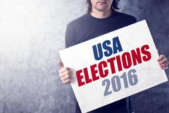 USA elections 2016, man holding poster Stock Photos