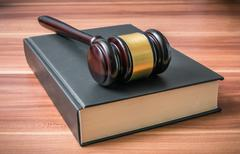 Wooden gavel on book. Justice and law concept. Stock Photos