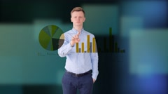 Young man standing in front of digital touch pad screen Stock Footage