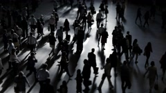 Abstract black and white scene of people walking on crowded street Stock Footage