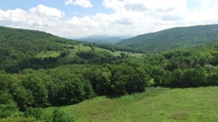 4K aerial footage rising above the trees in the Catskills, in upstate New York. Stock Footage