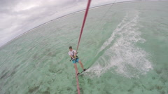 Aerial of man wakeboarding in the sea Stock Footage