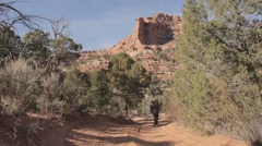 Two female hikers walking on dirt track Stock Footage