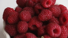 Fresh raspberry rotation in white bowl. Stock Footage