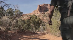 Hikers walking on dirt track Stock Footage