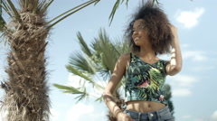 Beautiful teenage Afro American girl on tropical beach smiling to a camera. Stock Footage