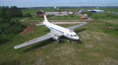 Panorama of  old airplane on field aerial view Stock Footage