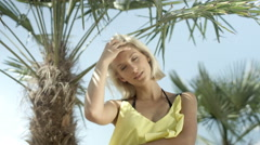 Sexy blonde girl posing on tropical beach. Stock Footage