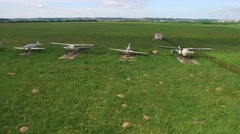 Old and new propeller aircraft in  field Stock Footage