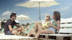 Group of young people enjoying vacation, outdoors. Stock Footage