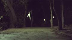 4K Scary ominous  dark urban park at night Stock Footage