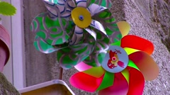 Colored Pinwheel for children in a balcony Stock Footage