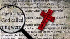 Magnifying glass on bible and cross Stock Footage