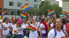 4K Gay Pride Parade - Young People With Rainbow Flags and Dancing Stock Footage