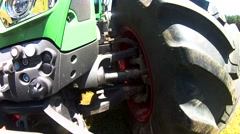 The wheel of a large tractor in motion. First-person view. Stock Footage