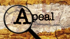 Magnifying glass on appeal text Stock Footage