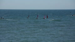 Wind surfers in the Sea Stock Footage