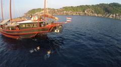 Kids swimming around boat summer fun Stock Footage