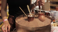Woman Prepares Turkish Coffee on the Hot Sand Stock Footage