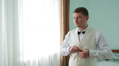 Young bride dress and shirt buttons.Happy young groom on their wedding day.Man Stock Footage