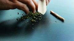 Marijuana Joint Paper Being Filled Stock Footage