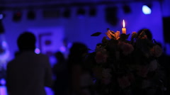 Young people dancing on the background of a burning candle Stock Footage