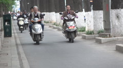 Motorbikes in China slow motion Stock Footage