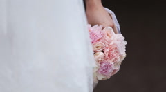 Bride with a bouquet of flowers Stock Footage