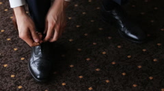 Man tying shoelaces Stock Footage