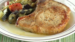 Pork chops with vegetables Stock Footage