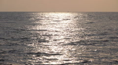Ocean surface sunset reflection slow motion Stock Footage