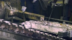Aluminum smelting, workers taking the sample probe Stock Footage