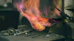 Melting furnace, out from under the cover of which escapes fire Stock Footage