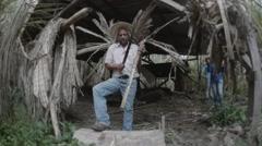 Ecuadorian peasant cuts a sugar cane Stock Footage