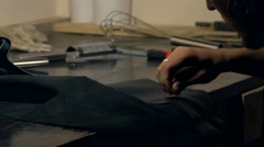 Furrier works with synthetic leather fabric. Handmade  professional accessory. Stock Footage