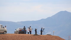 Photographers on hill viewpoint Stock Footage