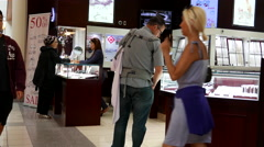 People shopping at Arctic Canadian Diamond jewelry store Stock Footage