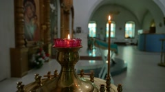 Dark candles in the church russian orthodox of service sacrament slow motion Stock Footage