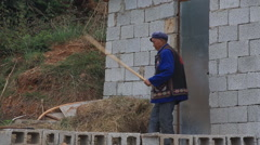 Traditional old man hill tribe working hay Stock Footage