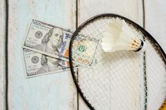 Money and badminton shuttlecocks Stock Photos