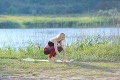 Young beautiful woman shows press stomach workout training wearing top Kuvituskuvat