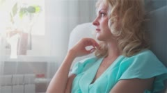 Beautiful sad young woman crying at home looking out the window 2 Stock Footage