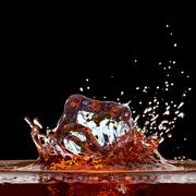 Cola ( or whisky ) splash against black 3D render Stock Illustration