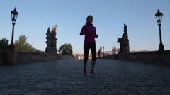 Jogger on Charles Bridge Prague Czech Republic Stock Video - stock footage