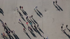 Overhead View of Crowd of People and Shadows Stock Video Stock Footage