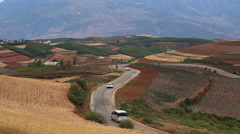 Windy road red hills China Stock Footage