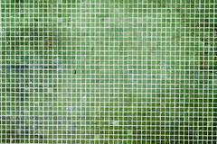 Grunge Green mosaic tiles background Stock Photos