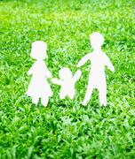 Paper Family icon on green grass Stock Photos